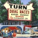 Details: Sign of the times at the drag strip.